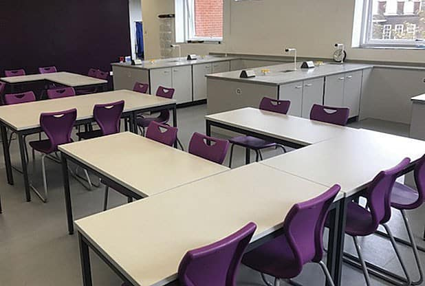 Royal Masonic School theory space that encourages learning and student engagement. Featuring purple chair in the schools colours creating a beautiful modern aesthetic.