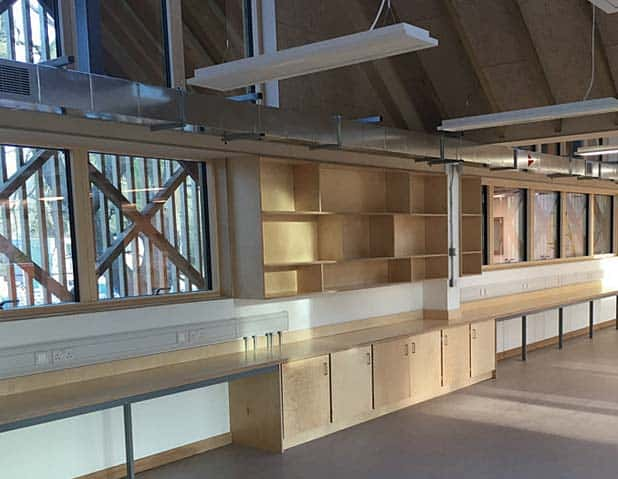 Overview of bespoke birch ply Art Hub with partitioned wall and mounted display units.