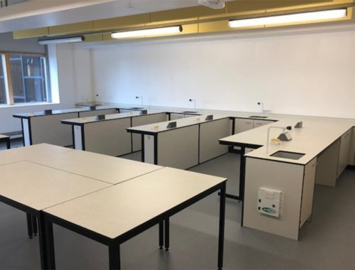 Loose tables arranged centrally in third lab