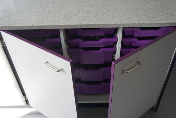 Velstone work top with grey cupboard featuring purple contract edging and purple singe and double Gratnells' Trays.